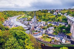 Aerial view of the historic town of Dinan with Rance river with. Dramatic cloudscape, Cotes-d'Armor department. Brittany (Bretagne), France Royalty Free Stock Photo