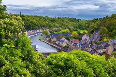 Aerial view of the historic town of Dinan with Rance river with dramatic cloudscape, Cotes-d'Armor department. Brittany (Bretagne. ), France royalty free stock photo