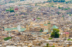 Aerial view of historical Moroccan Arabic town Fez with its city wall and soukhs.  Royalty Free Stock Images