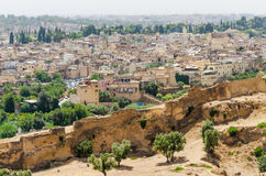 Aerial view of historical Moroccan Arabic town Fez with its city wall and soukhs.  Royalty Free Stock Photo