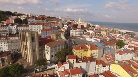 Aerial view of historical part of Lisbon and Lisbon Cathedral at sunny day Portugal stock footage