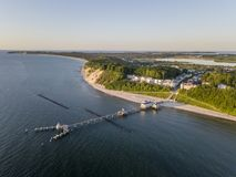 Aerial view of historical pier and the resort of Sellin on Ruegen island at sunrise stock photos