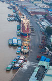 Aerial view of Ho Chi Minh city riverside around Nha Rong port at the evening. Stock Images