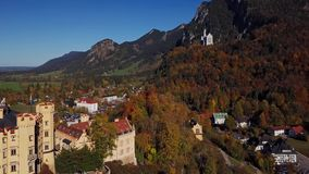 Aerial view of Hohenschwangau and Neuschwanstein Castle, Germany. Flight over of Hohenschwangau and Neuschwanstein Castle, Bavaria, Germany stock video