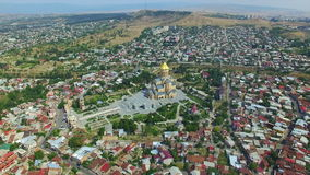 Aerial view of Holy Trinity Cathedral Tsminda Sameba in Tbilisi stock footage