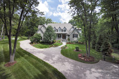 Aerial view of home with front porch. Aerial view with a drone of an upscale home with front porch in a suburban setting Royalty Free Stock Photo