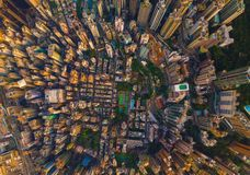 Aerial view of Hong Kong Downtown, China. Financial district and business centers in smart city in Asia. Top view of skyscraper. And high-rise buildings at royalty free stock image