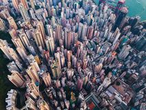 Aerial view of Hong Kong Downtown. Financial district and business centers in smart city in Asia. Top view of skyscraper and high royalty free stock images