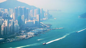 Aerial view of Hong Kong Island. Busy Financial District at Victoria Harbor stock video footage