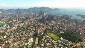Aerial view of Hong Kong Scene with Victoria Harbour in sunny day stock footage