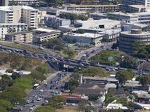 Aerial view of Honolulu Cityscape, H-1 Highway overpass, moiliili and buildings royalty free stock photography