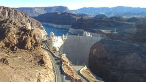 Aerial View of Hoover Dam. Aerial view over Hoover Dam in the Black Canyon of the Colorado River, on the border between the U.S. states of Nevada and Arizona royalty free stock image