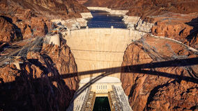 Aerial View of Hoover Dam and Shadow of Pat Tillman Bridge Stock Photo