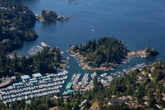 Aerial view of Horseshoe Bay. Aerial view of Marina and Residential homes by the ocean shore. Taken in Horseshoe Bay, West Vancouver, BC, Canada stock photos