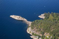 Aerial view of Horseshoe Bay. Aerial view of Whytecliff Park during a vibrant sunny summer day. Taken in Horseshoe Bay, West Vancouver, BC, Canada royalty free stock images