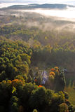 An aerial view of a hot air balloon floating over the Vermont country side Stock Photo