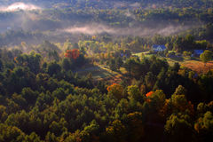 An aerial view of a hot air balloon floating over the Vermont country side Stock Images