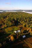 An aerial view of a hot air balloon floating over the Vermont country side Royalty Free Stock Image