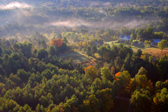 An aerial view of a hot air balloon floating over the Vermont country side Royalty Free Stock Images