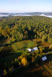 An aerial view of a hot air balloon floating over the Vermont country side Royalty Free Stock Photo