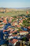 Aerial view of hot air balloon flying over buildings in city,. Cappadocia, Turkey stock photography