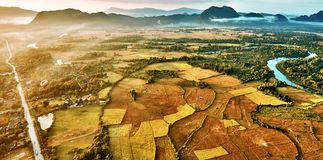 Aerial view of a hot air baloon over rice fields in rocky mounta Stock Image