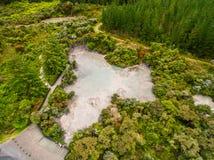 Aerial View of Hot Mud Pool, Rotorua, New Zealand. Bubbling Hot Mud Pool in Rotorua, New Zealand from Aerial View by Drone. Rotorua in North Island of New Royalty Free Stock Photo