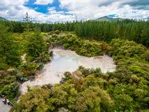 Aerial View of Hot Mud Pool, Rotorua, New Zealand. Bubbling Hot Mud Pool in Rotorua, New Zealand from Aerial View by Drone. Rotorua in North Island of New Stock Image