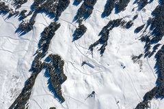 Aerial view of a house covered in snow in winter in the mountains stock images