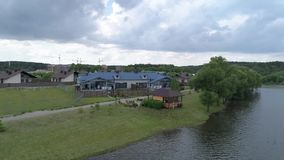 Aerial view at the house on the lake stock video footage