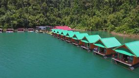 Aerial View on Houses at Cheow Lan Lake, Khao Sok National Park in southern Thailand. HD Slowmotion. stock footage