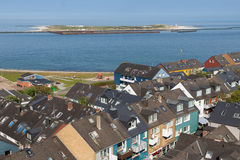 Aerial view at houses of German island Helgoland and a view at D. Aerial view at houses of German island Helgoland and a view at the nearby island Dune royalty free stock images