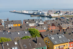 Aerial view at houses and harbor of German island Helgoland. In the Northsea stock photography