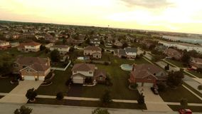 Aerial view houses in residential suburban neighborhood with backyard landscape and rooftops stock video