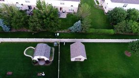 Aerial view houses in residential suburban neighborhood with backyard landscape and rooftops Stock Images