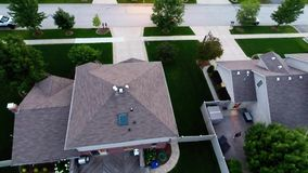 Aerial view houses in residential suburban neighborhood with backyard landscape and rooftops Royalty Free Stock Images