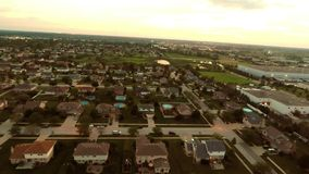 Aerial view houses in residential suburban neighborhood with backyard landscape and rooftops Royalty Free Stock Photos