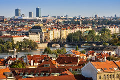 Aerial view of houses, roofs and Charles Bridge of Prague. Stock Images
