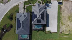 Aerial view of houses with solar energy panels on roofs, small ecology suburbs, shot in 4k stock footage