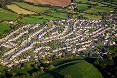 Aerial view of housing estate. Aerial view of an English housing estate surrounded by green fields Royalty Free Stock Photos
