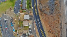Aerial view of an housing estate on the city with railway tracks close to the buildings, drones shot. A height for your design stock video footage