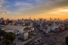 Aerial view Hua Lamphong train station and modern office buildings in Bangkok city downtown with sunrise time Royalty Free Stock Image