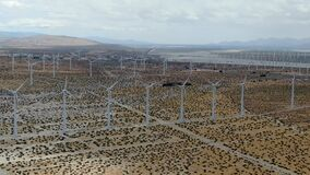 Aerial view of huge array of gigantic wind turbines spreading over the desert in Palm Springs.