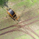 Aerial view of a huge hose cart used by the farmers to irrigate the arable land, Germany near Gifhorn. Made with drone Royalty Free Stock Photo