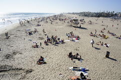 An Aerial View Of The Huntington Beach. People are scattered on the white sand of the Huntington Beach and enjoy swimming Stock Image