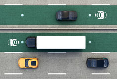 Aerial view of hybrid truck and blue electric car on wireless charging lane Stock Photo