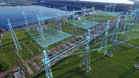 An aerial view a hydroelectric power station with infographic power flows motion graphics. Electric substation with tall