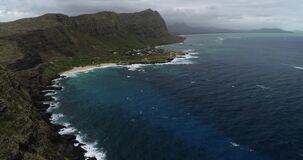 Aerial view, Hyperlapse of panorama off the coast of Hawaii, in aquamarine water _