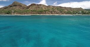 Aerial view, Hyperlapse of panorama off the coast of Hawaii, in blue water _