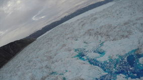Aerial view of Ice Glacier flows stock footage